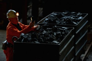 NEWTONGRANGE, SCOTLAND - APRIL 09:  John Kane, former miner and tour guide at the National Mining Museum Scotland, looks at a piece of coal on April 9, 2013 in Newtongrange, Scotland. Downing Street have announced that the funeral of Prime Minister Baroness Thatcher will take place on Wednesday the 17th of April at St Paul?s Cathedral.  (Photo by Jeff J Mitchell/Getty Images)